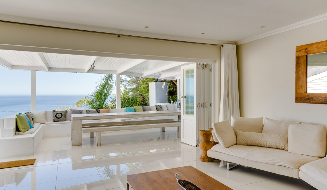 Looking out from living room to exterior dining and view