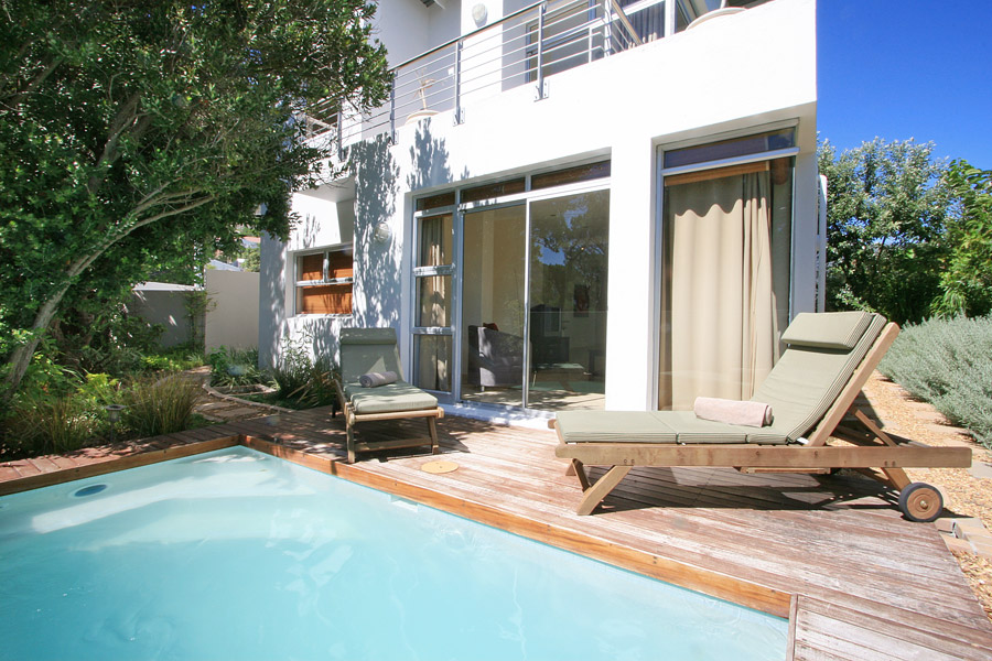 Immaculate  fully furnished  3 bedroom duplex townhouse with private plunge pool and garden.